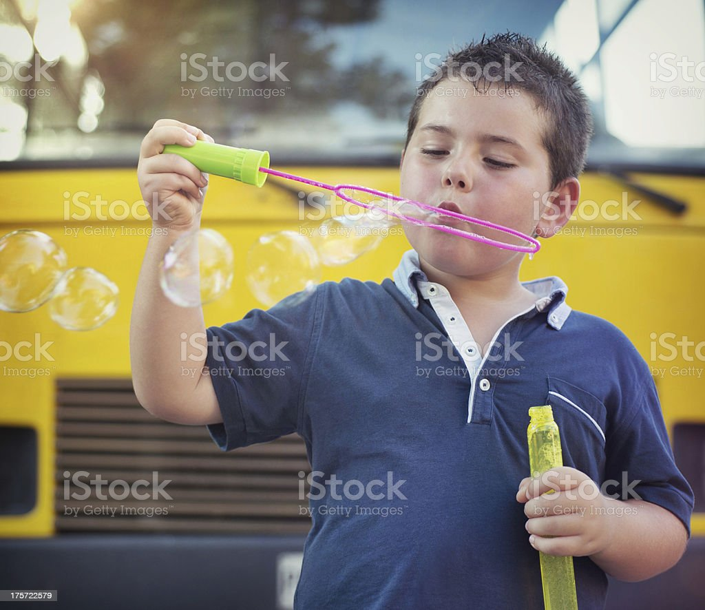 Back to School. Child blowing soap bubbles royalty-free stock photo