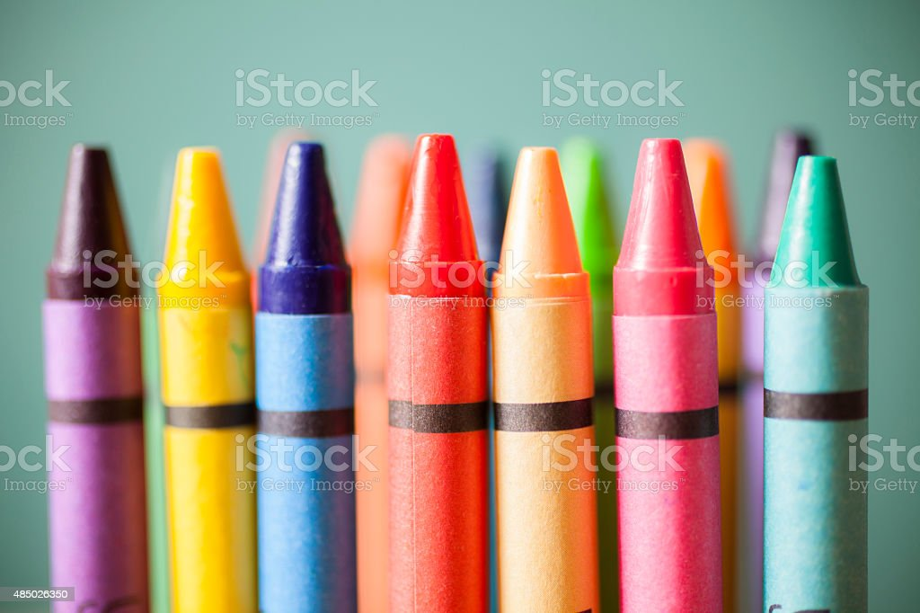 Back to school.  Close-up of colorful crayons in a row. stock photo