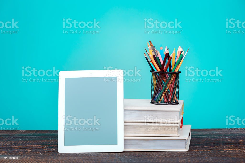 Back to School concept. Books, colored pencils and laptop stock photo