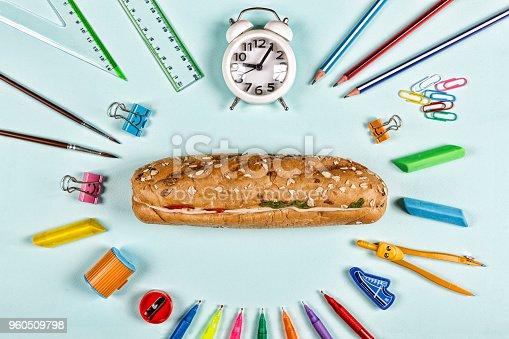 istock Back to school concept. education, school snack, school supplies, student, college, flatlay, eating outdoor 960509798
