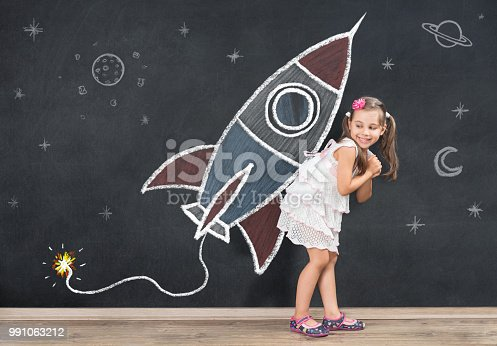 istock Back to School Concept. Happy Schoolgirl is Ready for a New Start. 991063212