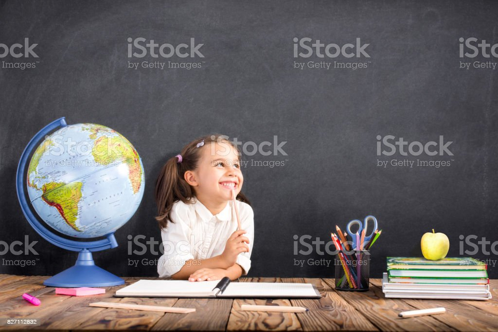 Back To School Concept, Happy Smiling Child Studying stock photo