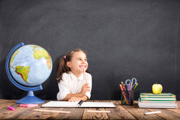 Back To School Concept, Happy Smiling Child Studying - foto stock