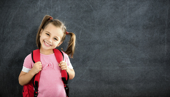 istock Back To School Concept, Happy Smiling Schoolgirl Studying 831574302