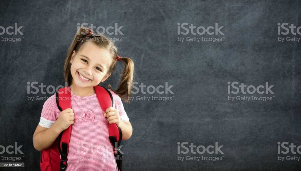 Back To School Concept, Happy Smiling Schoolgirl Studying stock photo