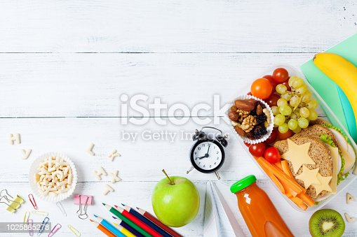 istock Back to school concept. Healthy lunch box and colorful stationery top view. 1025865278