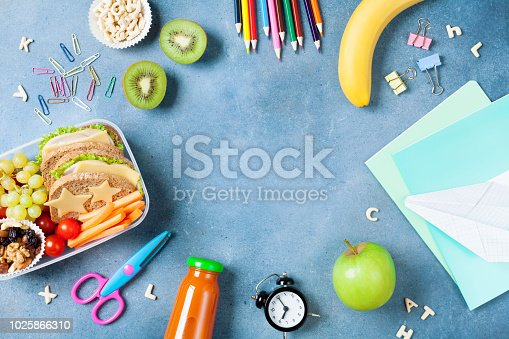 istock Back to school concept. Healthy lunch box and colorful stationery top view. 1025866310