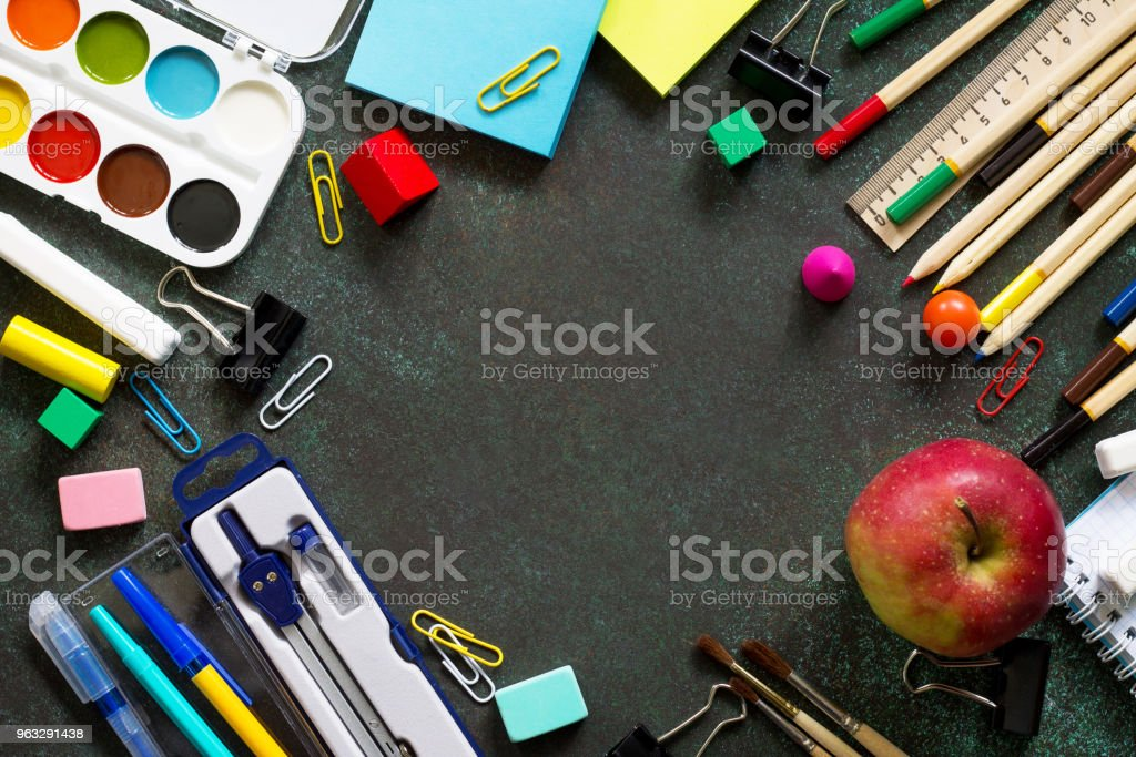 Back to school concept. Items for the school on blackboard dark table. Top view flat lay background, copy space. stock photo
