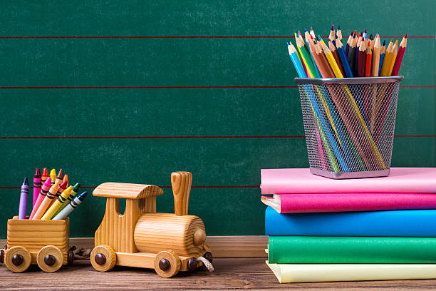 back to school concept, pencils and books with toy train - kindergarten workshop stock-fotos und bilder