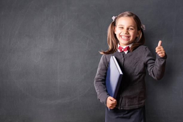 Back To School Concept, Portrait of Happy Smiling Child Student bei Blackboard – Foto