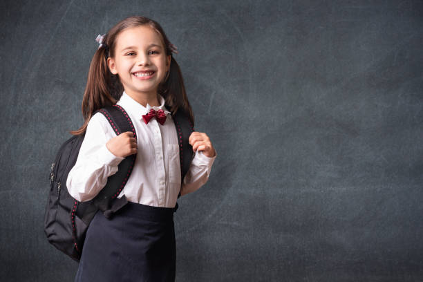 Back To School Concept, Portrait of Happy Smiling Child Student at Blackboard stock photo