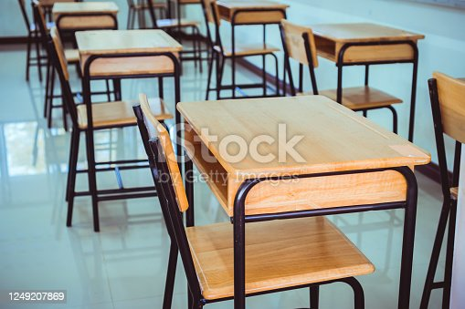 1047047834 istock photo Back to school concept. School empty classroom, Lecture room with desks and chairs iron wood for studying lessons in highschool thailand without young student, interior of secondary education 1249207869