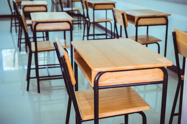 Back to school concept. School empty classroom, Lecture room with desks and chairs iron wood for studying lessons in highschool thailand without young student, interior of secondary education stock photo