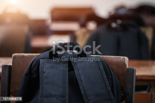 istock Back to school concept. School empty classroom, Lecture room with backpack on desks and chairs iron wood for studying lessons in highschool thailand no young student, interior of secondary education 1074969076