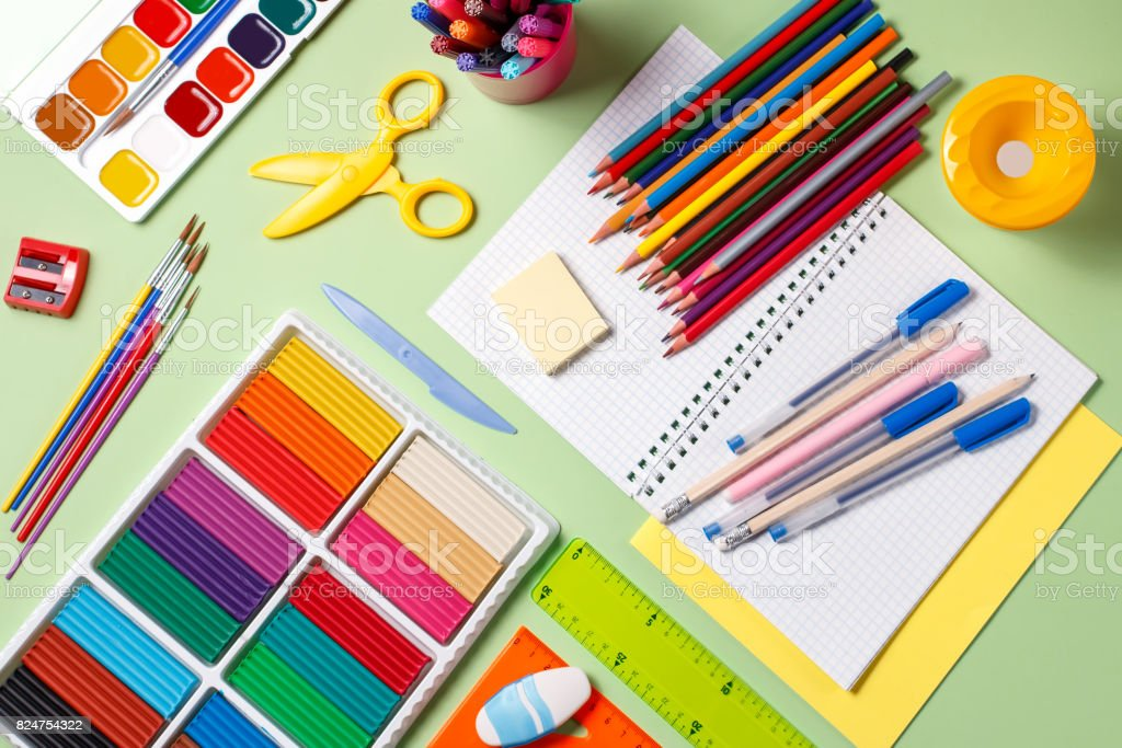 Back to school concept. School supplies on a pastel background stock photo