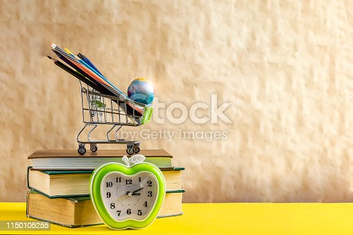 1045293630istockphoto Back to school concept. Stack of books with school supplies in shopping cart 1150105255
