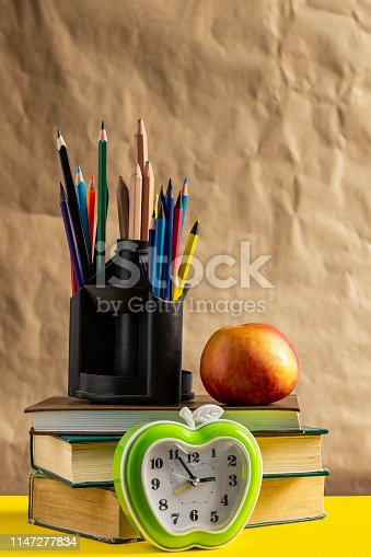 1045293630istockphoto Back to school concept. Stack of books with school supplies 1147277834