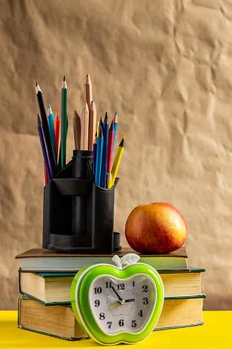 1045293630 istock photo Back to school concept. Stack of books with school supplies 1147277834
