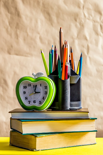 1045293630 istock photo Back to school concept. Stack of books with school supplies 1148057383