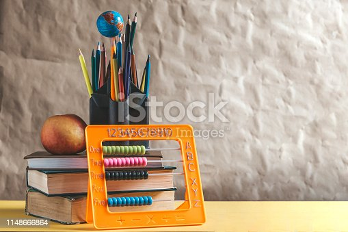 istock Back to school concept. Stack of books with school supplies 1148666864
