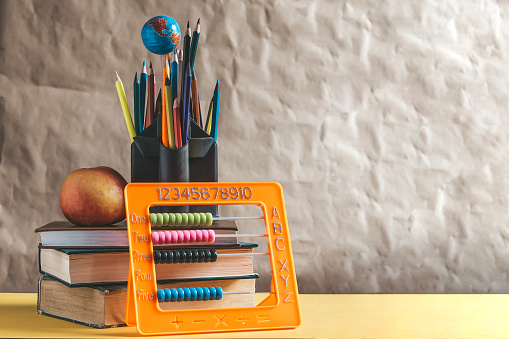 1045293630 istock photo Back to school concept. Stack of books with school supplies 1148666864