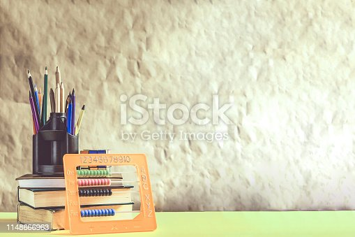 istock Back to school concept. Stack of books with school supplies 1148666963
