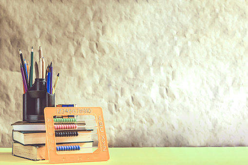 1045293630 istock photo Back to school concept. Stack of books with school supplies 1148666963