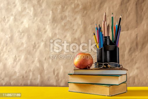 1045293630istockphoto Back to school concept. Stack of books with school supplies 1148672189