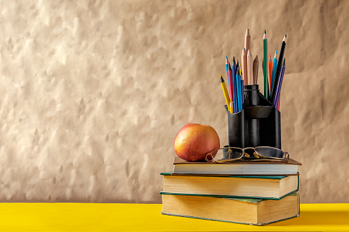 1045293630 istock photo Back to school concept. Stack of books with school supplies 1148672189