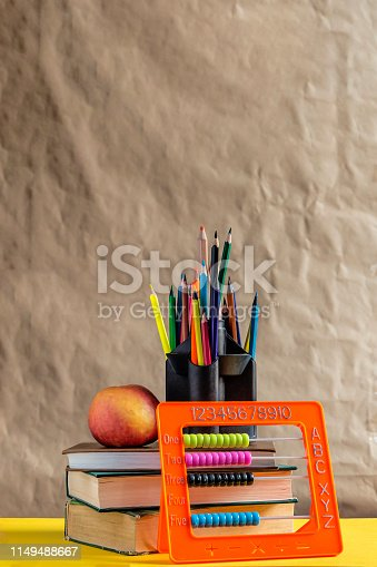 1045293630istockphoto Back to school concept. Stack of books with school supplies 1149488667
