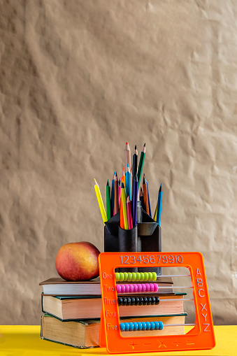 1045293630 istock photo Back to school concept. Stack of books with school supplies 1149488667