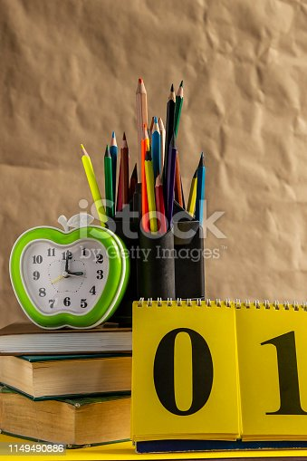 1045293630istockphoto Back to school concept. Stack of books with school supplies 1149490886