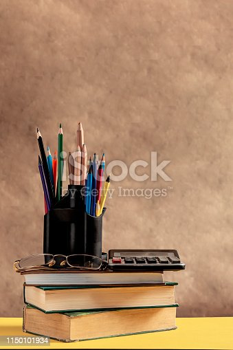 1045293630istockphoto Back to school concept. Stack of books with school supplies 1150101934