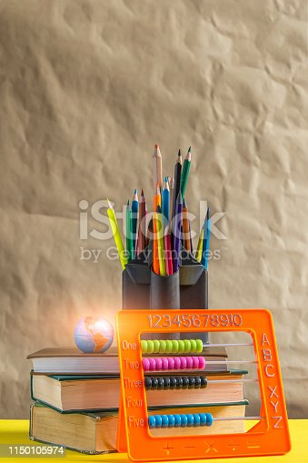 1045293630istockphoto Back to school concept. Stack of books with school supplies 1150105974