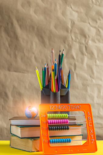 1045293630 istock photo Back to school concept. Stack of books with school supplies 1150105974