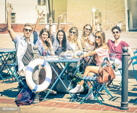 Back to school concept with a group of happy best friends - Tourists having fun in the summer around the old town - University students during a break in a sunny day - Vintage filtered look