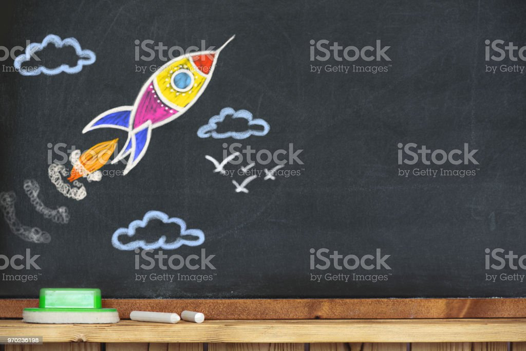 Back to School Concept with Hand Drawn Rocket on Blackboard stock photo