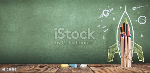 istock Back to School Concept with Hand Drawn Rocket on Blackboard 991036668