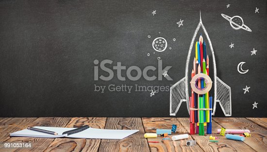 istock Back to School Concept with Hand Drawn Rocket on Blackboard 991053164
