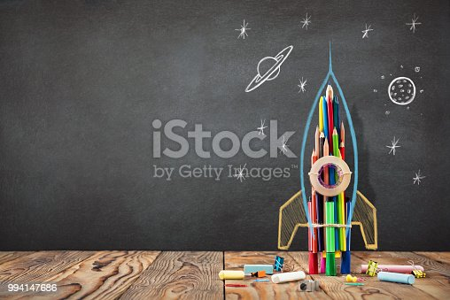 istock Back to School Concept with Hand Drawn Rocket on Blackboard 994147686