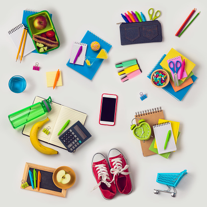 Back to school concept with school supplies on white background. View from above. Flat lay