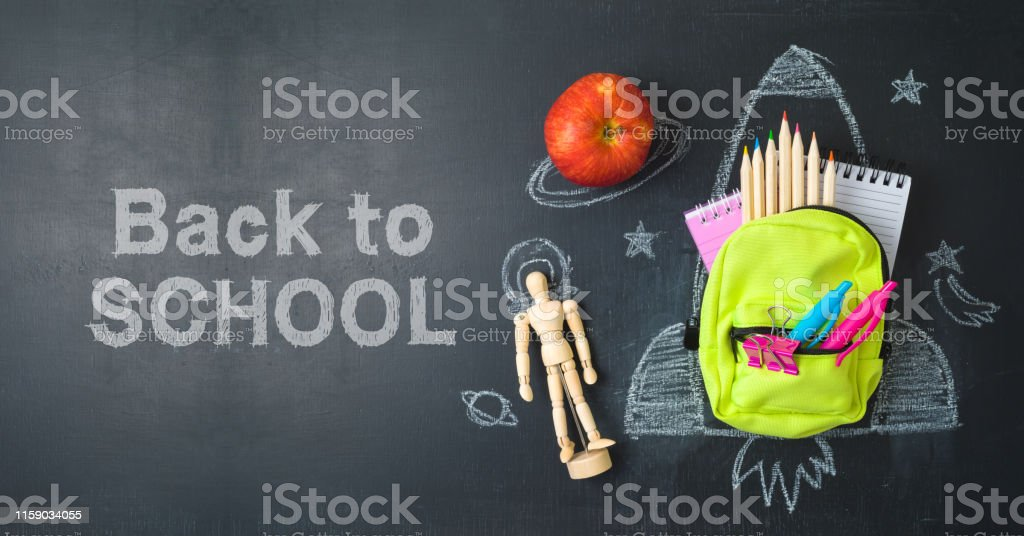 Back to school concept with small bag backpack, school supplies and...