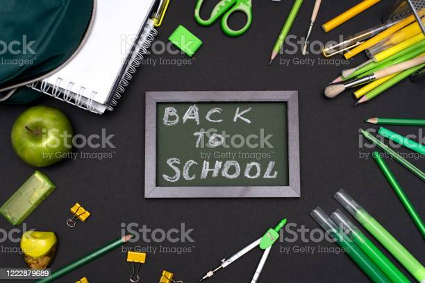 Back to school concept with stationery supplies and blackboard picture id1222879689?b=1&k=6&m=1222879689&s=612x612&h=gt2p2ouprhryin laywgizlbx rk 9moni4demz1flu=