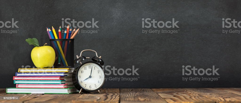 Back to School Concept with Stationery Supplies and Blackboard stock photo