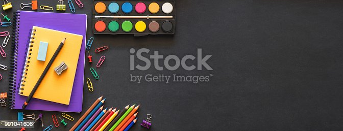 istock Back to School Concept with Stationery Supplies and Blackboard 991041606