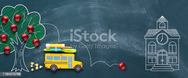 istock Back to school concept with yellow school bus 1164370799