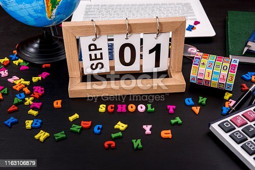 istock Back to school concept, wooden calendar and colorful alphabet 1163106879