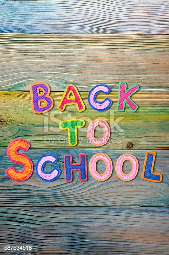 istock Back to School desk table top view, words on grunge 587534518