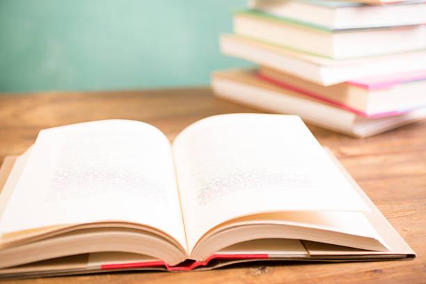 Back to school. Education. Textbooks on desk. Chalkboard. stock photo