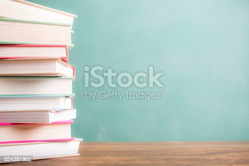 istock Back to school. Education. Textbooks stacked on desk. Chalkboard. 524381902